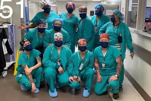 A group of nurses and other health care workers show off protective masks made for them by Arizona volunteers. (Mask-Making-4-AZ)