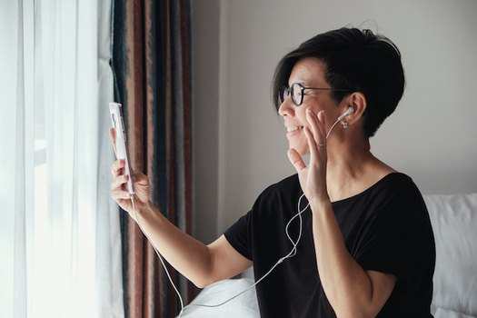 Health professionals say it's important to maintain social connections, such as over the phone, while in isolation from COVID-19. (sewcream/Adobe Stock)