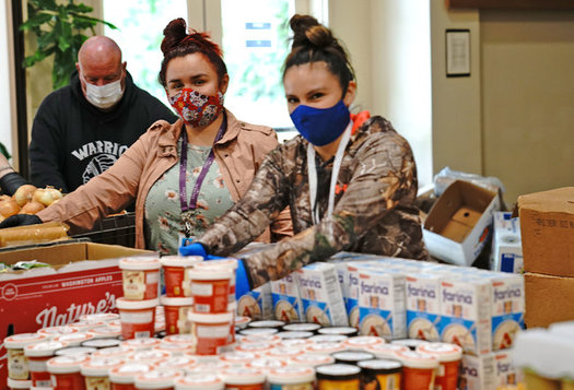 Yurok Health and Human Services staff members Courtney Mattz and Cassandra Charles assemble weekly food boxes. (Matt Mais/Yurok Tribe)
