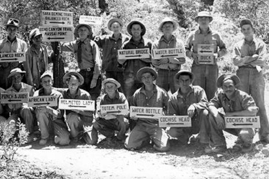 Civilian Conservation Corps workers display the handmade signs they created to post along a newly constructed trail system in 1937 at the Chiricahua National Monument in Arizona. (University of Arizona Library)