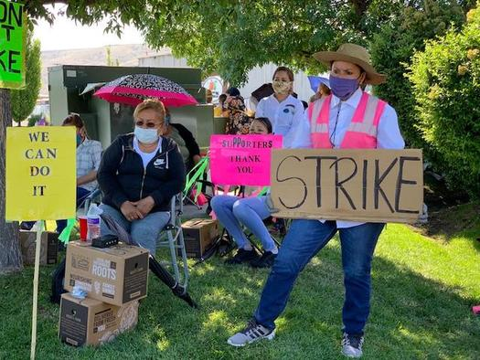 Workers are on strike at four of the six fruit packing warehouses in Yakima Valley. (Shauri Tello)