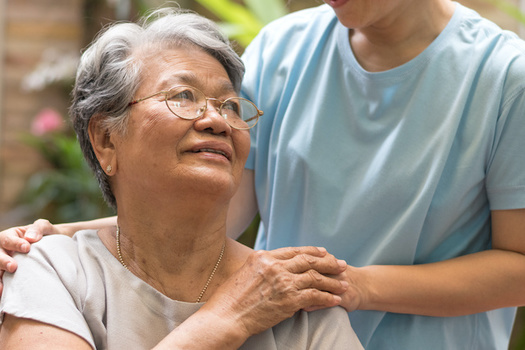 Family caregivers spend nearly 24 hours a week on average providing care, according to AARP. (Khunatorn/Adobe Stock)