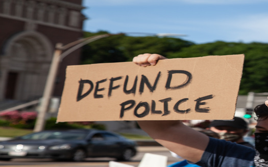 A new Monmouth University poll found 77% of respondents believe that activists calling for police overhauls don't actually mean getting rid of law enforcement altogether. (Adobe Stock)