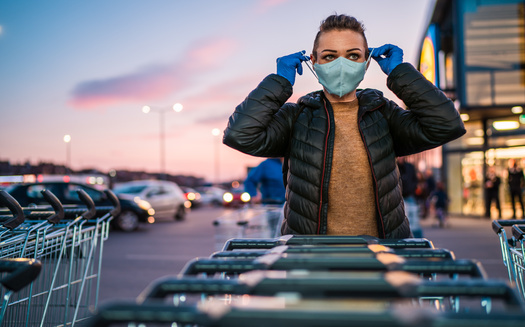 Health experts say public compliance with mask use could play a big role in slowing the spread of COVID-19. (Adobe Stock)