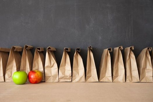 Grab-and-go meals have been helpful in expanding the reach of traditional school nutrition programs during the pandemic. (Adobe Stock)