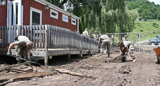 West Virginia National Guard members remove debris after a 2019 flood in Harman. Damaging floods have increased in the state along with the climate crisis. (U.S. National Guard)