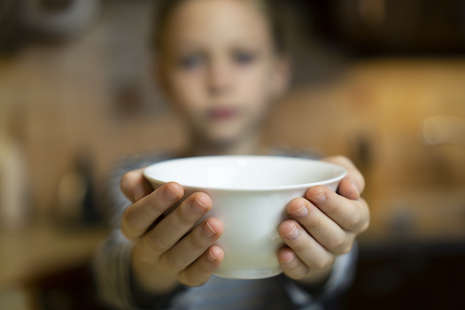 Half of New York City public-school families report reducing the size or frequency of kids' meals. (Trailbomber/Adobe Stock)