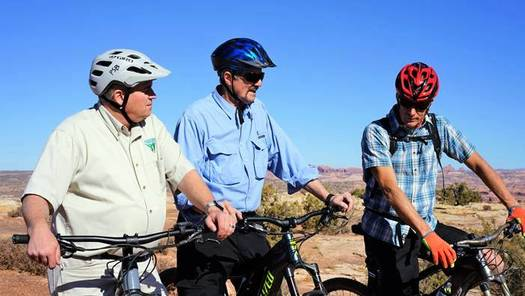 Acting Director of the Bureau of Land Management, William Pendley Perry (center), tours outdoor trails near Moab in 2019 with several BLM staff members. (BLM)