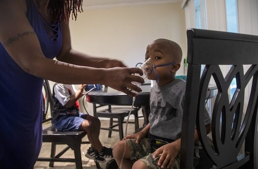 Four-year-old Jeremiah Galbreath receives a nebulizer treatment for asthma at his home in Bayboro.  (Travis Long)