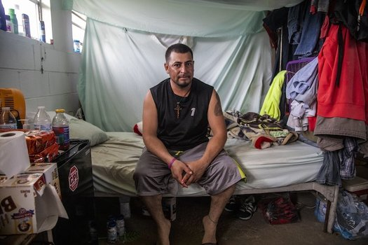 Jos Indalecio, a tractor operator, sits in his living quarters at a Johnston County farmworker camp on Aug. 27. The camp does not have air conditioning, which is considered a luxury by many farmworkers in North Carolina. (Travis Long, TLONG@NEWSOBSERVER.COM)