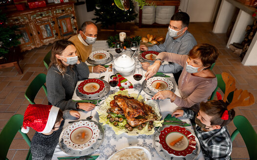 Experts advise using compassion if the conversation veers into difficult political territory around this year's holiday dinner table. (Adobe Stock)