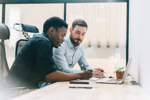Good communication skills can boost a person's wages up to 20%, according to a new report. (BullRun/Adobe Stock)