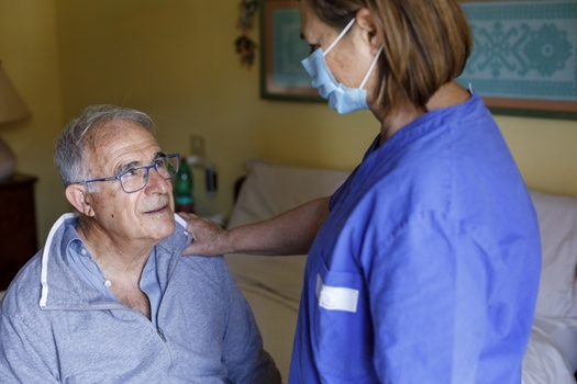 Nursing home residents are among the most vulnerable to COVID-19, which also puts staff at higher risk. (Adobe Stock)