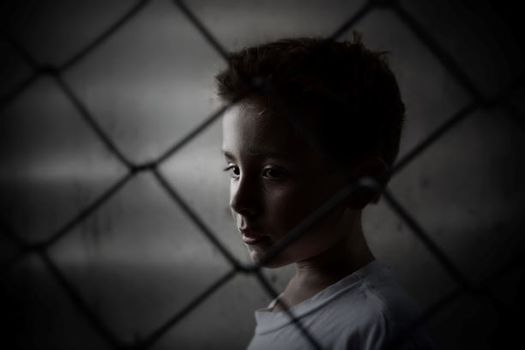 A human rights report gives Illinois 3.5 points out of 10 for how kids are treated in the criminal-justice system. (AdobeStock)