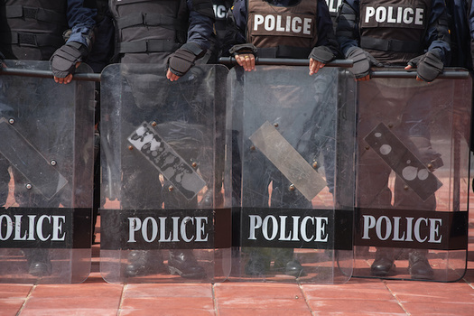 Civil-rights advocates point out that police regularly confront social-justice demonstrations with militarized force. (saksuvan/Adobe Stock)