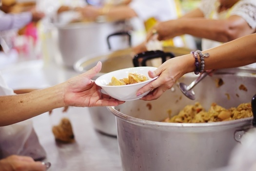 Volunteering at a soup kitchen or homeless shelter is one way to honor Dr. King's legacy of service. (Adobe Stock)