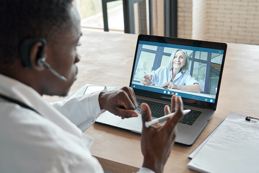 """Telehealth visits and """"smart scheduling"""" office visits can help patients keep up with care while staying safe from COVID. (insta_photos/Adobe Stock)"""