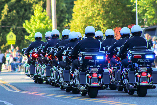 A coalition representing more than 14,000 police officers are giving the thumbs up to many reform efforts in Washington state. (Diego Gomez/Adobe Stock)
