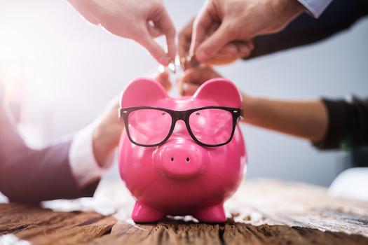 A new report says Washington credit unions waived $6.7 million in fees for their customers during the pandemic. (Andrey Popov/Adobe Stock)