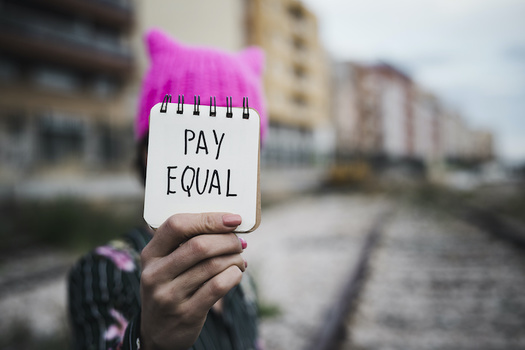Women's median weekly earnings for full-time work were $891 in 2020 compared with $1,082 for men. (nito/Adobe Stock)