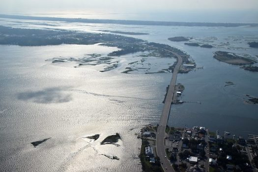 The view of water-surrounded downtown Swansboro, shown here in September 2019 at bottom right, reflects changes caused by Hurricane Florence a year earlier. (Mark Hibbs/SouthWings)