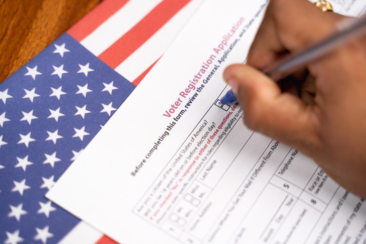 Some lawmakers are hoping to see Maine join the 40 other states plus Washington, D.C., which have online voter registration. (Lakshmiprasad/Adobe Stock)