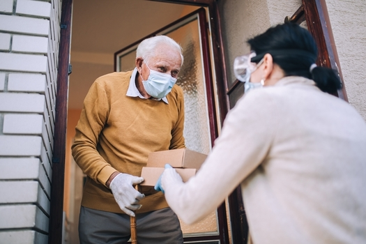 """The pandemic forced many """"Meals on Wheels"""" and similar programs to limit their daily deliveries to older adults, but they hope to expand with new funds from the American Rescue Plan. (Mediteraneo/Adobe Stock)"""