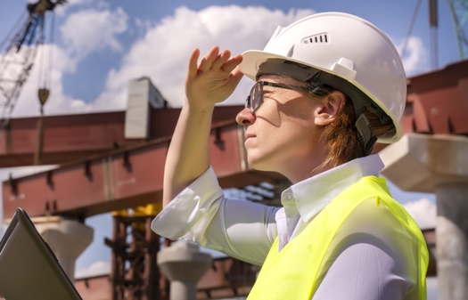 Under President Joe Biden's infrastructure program, thousands of new workers would be needed to improve bridges and roadways, repair water and wastewater systems and build a clean-energy economy. (denklim/Adobe Stock)<br /><br />