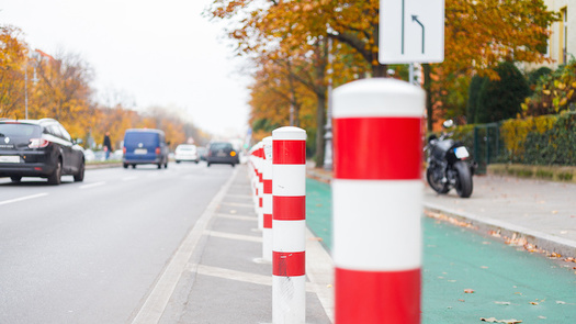 Research shows cities that plan and install protected lanes for cyclists have fewer bike and pedestrian fatalities than those that do not. (Adobe Stock)