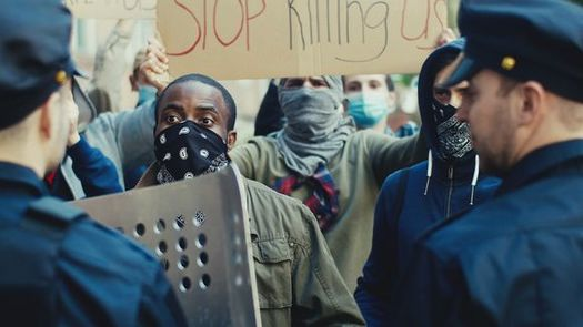 Racial-justice protests reached a global scale last year, but in some states and cities, how police respond to demonstrators remains a thorny issue. (Adobe Stock)