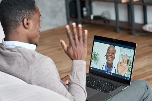 Research shows more Americans are turning to laptops and smartphones for virtual visits with doctors. (Adobe Stock)
