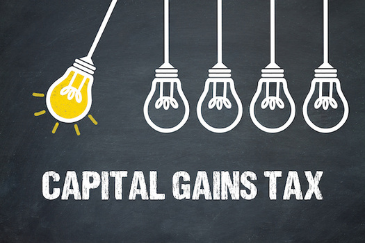 Washington state's capital gains tax is expected to bring in about $415 million in 2023. (magele-picture/Adobe Stock)