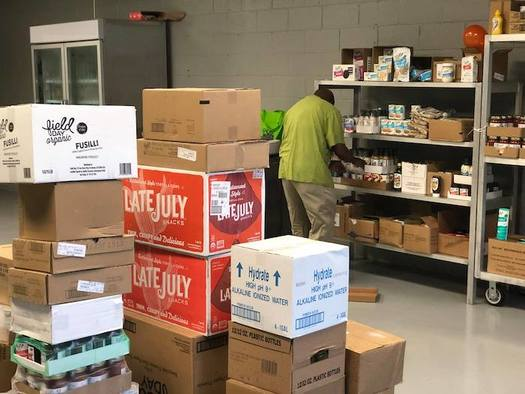 Volunteers stock shelves at SHARE Cooperative in Winston-Salem. (Facebook)