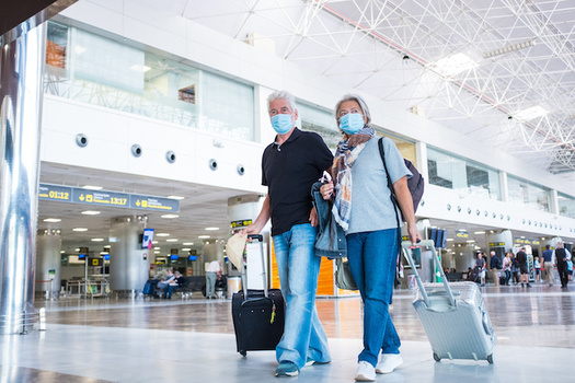 The CDC recommends people wait until they're fully vaccinated before traveling domestically. (Fabio/Adobe Stock)