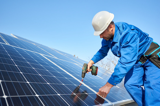 C-PACE financing can be used to install renewable energy sources like solar panels on commercial buildings. (anatoliy_gleb/Adobe Stock)
