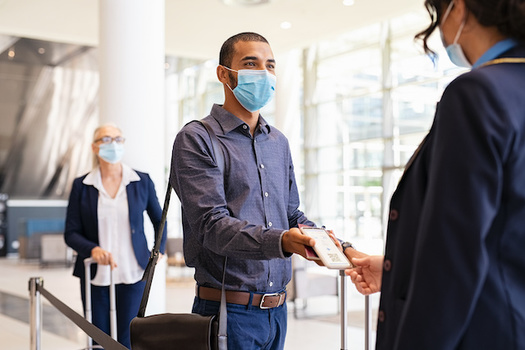 The Centers for Disease Control and Prevention has loosened mask recommendations for vaccinated people, but face coverings still are required in airports. (Rido/Adobe Stock)
