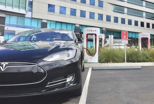 The infrastructure plan now before Congress includes funding to increase the number of E-V charging stations, such as this one at Qualcomm Stadium in San Diego. (Tonythetigerson/Twenty 20)