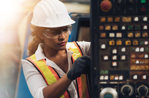 Raising women's hourly wages to match those of Wyoming men would add $153 million in labor income in a single year, a report says. (Adobe Stock)