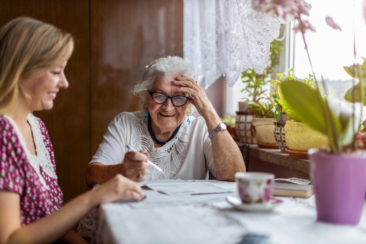 Family caregivers are spending, on average, 26% of their income on caregiving activities, according to an AARP report. (Adobe stock)