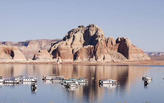 Lake Powell, a man-made reservoir situated on the Arizona-Utah border, draws upwards of 2 million visitors a year for boating and other forms of outdoor recreation. (forcdan/Adobe Stock)<br /><br /><br />