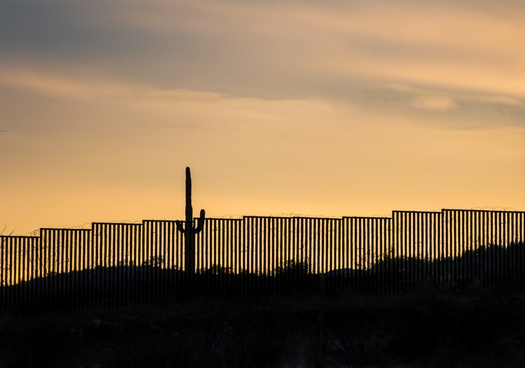 Almost 190 miles of wall on the U.S.-Mexico border in Arizona were built before President Joe Biden called a halt to construction earlier this year. (Elizabeth/Adobe Stock)