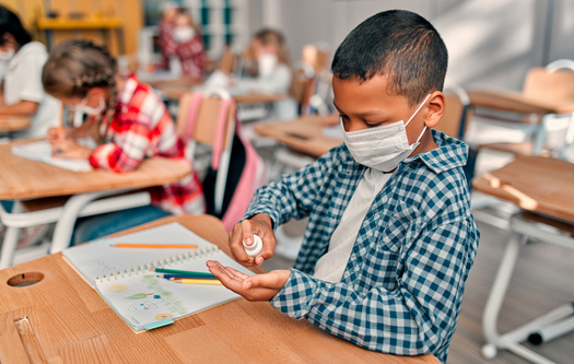 In addition to recommending teachers, students and school staff member mask up indoors this fall, new CDC guidelines recommend even vaccinated people wear masks in areas with high COVID case numbers. (Vasyl/Adobe Stock)