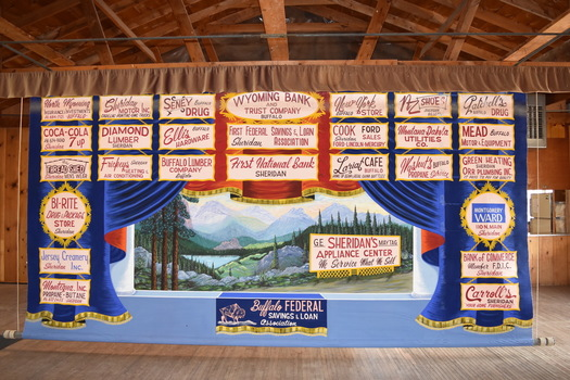 Advertising curtains, such as this one inside Kearney Community Hall, are common in community halls as stage backdrops, and were used to raise funds through local businesses paying to have ads. (Andrea Graham/Alliance for Historic Wyoming)