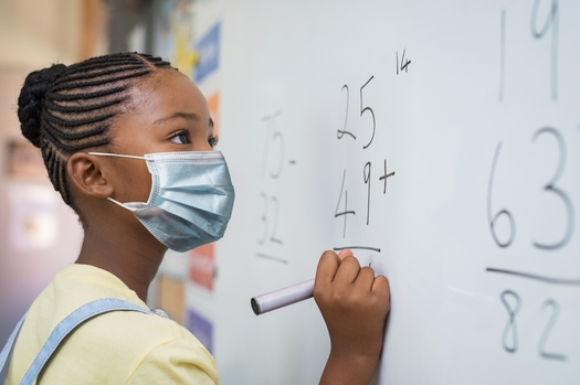 Despite concerns of Utah parents that school-age children could be vulnerable to COVID-19 when they return to class, the state bars school districts from requiring face masks. (Rido/Adobe Stock)