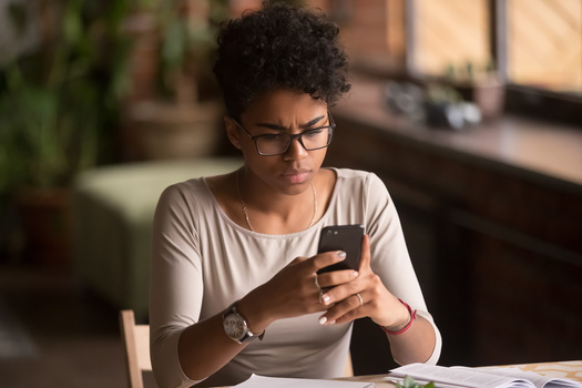 Almost half of all Black adults say they do not answer a call from someone they do not know, but two thirds report using the same or similar passwords across different accounts. (Adobe Stock)