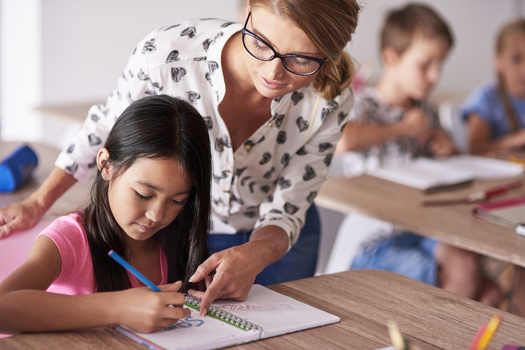 Advocates say South Dakota has made progress in compensating teachers, but still lags behind neighboring states, including trailing North Dakota educators by $4,000 in annual salary. (Adobe Stock)