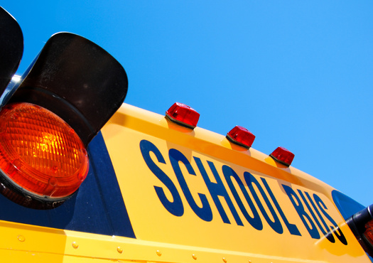 In a national survey, 50% of school transportation coordinators said the rate of pay is a major factor that affects their ability to recruit and retain school bus drivers. (Adobe Stock)