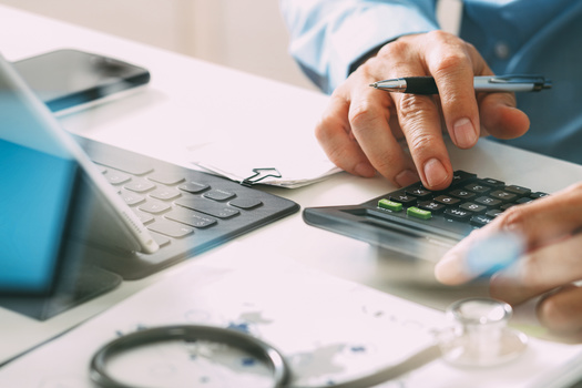 A recent poll finds 56% of Michigan voters have struggled to pay a medical bill, even while they had health insurance. (everythingpossible/Adobe Stock)