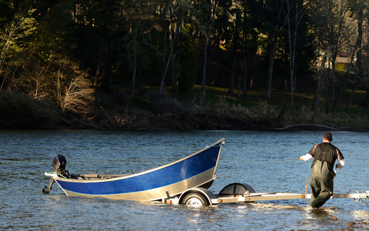 Anglers in the Columbia River Basin have been packing up earlier than normal this year. (ftfoxfoto/Adobe Stock)