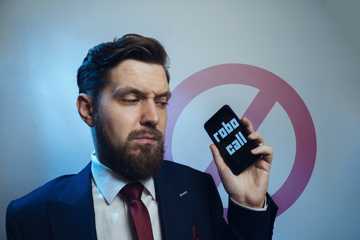 A new report finds more than 80% of U.S. telecom carriers, both big and small companies, are not doing all they can to stop illegal robocalls. (Phoenix021/Adobe Stock)